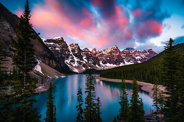 Moraine Lake in Banff, Alberta, Canada Dramatic Sunrise at Moraine Lake in Banff, Alberta, Canada canadian rockies stock pictures, royalty-free photos & images