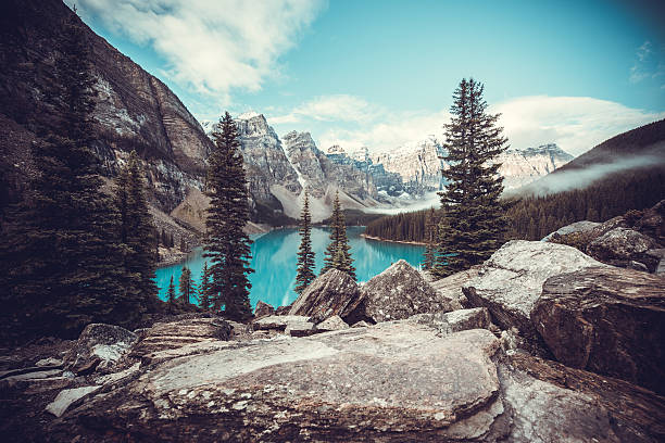 Moraine Lake in Banff National Park - Canada The crystal clear blue water of Moraine Lake surrounded by the Canadian Rockies. Banff National Park, Alberta. canadian rockies stock pictures, royalty-free photos & images