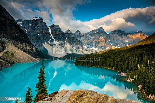 Lake Moraine in Banff National Park. Mountains of famous Ten Peaks reflecting in the beautiful calm turquoise water of the lake. Banff National Park, Alberta province in Canada.
