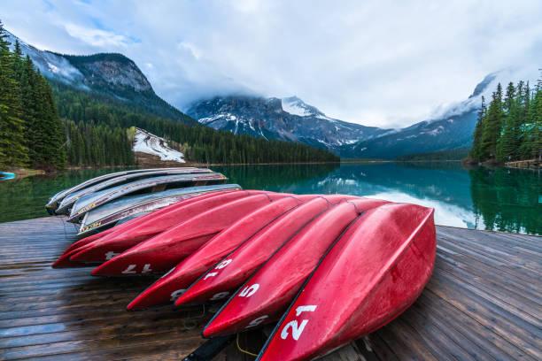 Moraine Lake Kayak Moraine Lake Kayak valley of the ten peaks stock pictures, royalty-free photos & images