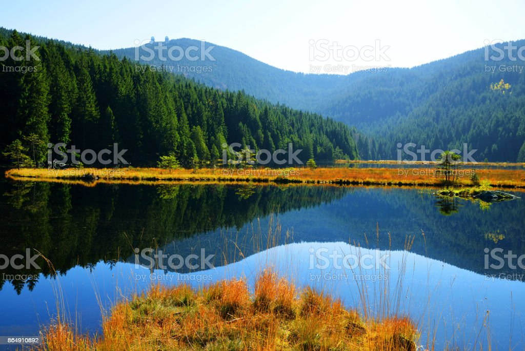 Moraine lake Kleiner Arbersee with mount Gross Arber in Germany. stock photo