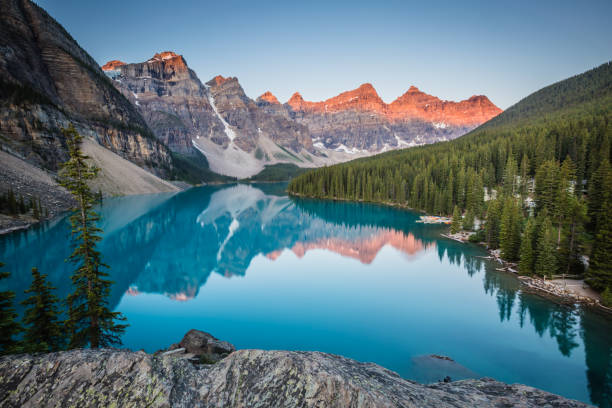 Moraine Lake Moraine Lake in Banff, Canada at sunrise. reflection lake stock pictures, royalty-free photos & images