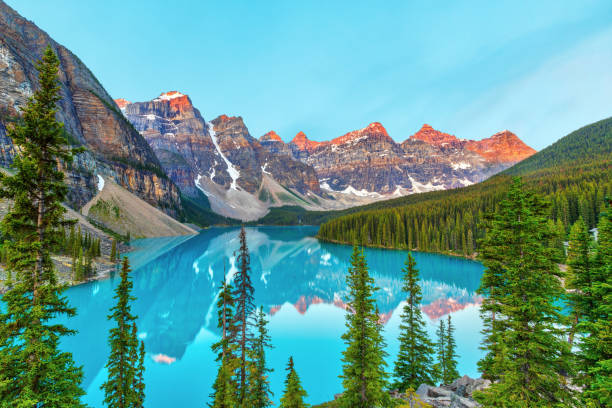 Moraine Lake Sunrise in the Canadian Rockies of Banff National Park Summer sunrise lighting up the Valley of the Ten Peaks at Moraine Lake near Lake Louise in the Canadian Rockies of Banff National Park, Alberta, Canada. valley of the ten peaks stock pictures, royalty-free photos & images