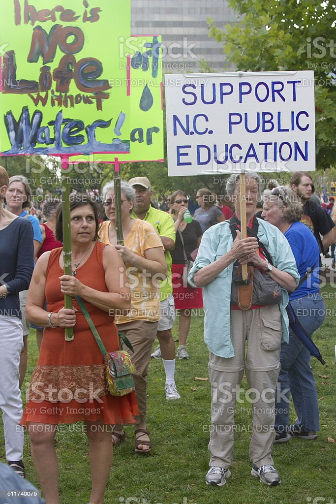 Moral Monday Protesters Holding Signs stock photo