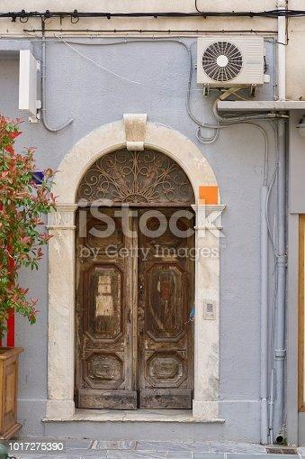 1124475954 istock photo morbid old wooden door of a grey home 1017275390