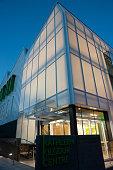 istock Mordern architectural building illuminated at dusk 1323736780