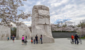 Visitors are fewer in number than is usual for cherry blossom season at the MLK Memorial in Washington DC, due to the ongoing coronavirus pandemic. Martin Luther King, Jr., Memorial,  Washington, DC.
