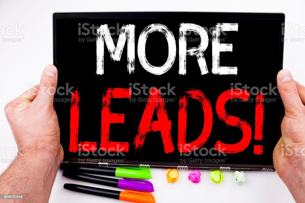 More Leads text written on tablet, computer in the office with marker, pen, stationery. Business concept for Get More Leads Consumer Marketing white background with copy space stock photo