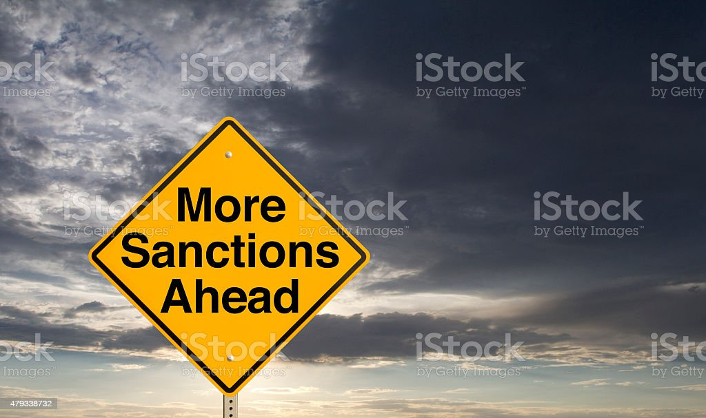"""More Sanctions Ahead A sign that says """"More Sanctions Ahead."""" 2015 Stock Photo"""