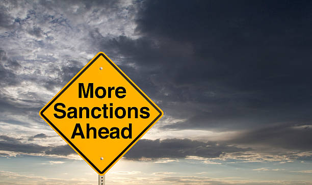 More Sanctions Ahead A sign that says