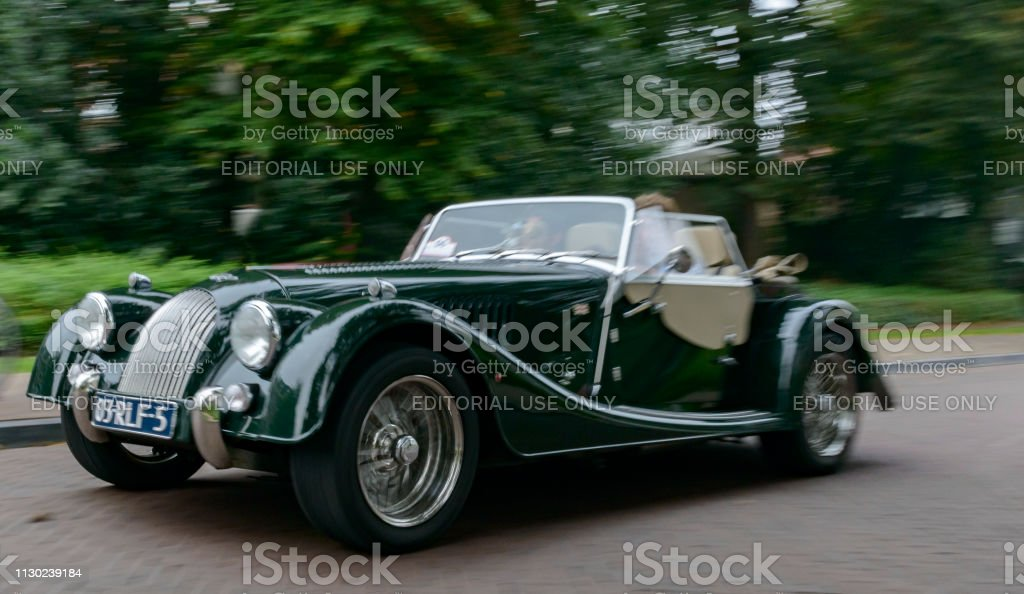 Morgan + Eight sportscar driving on the street stock photo