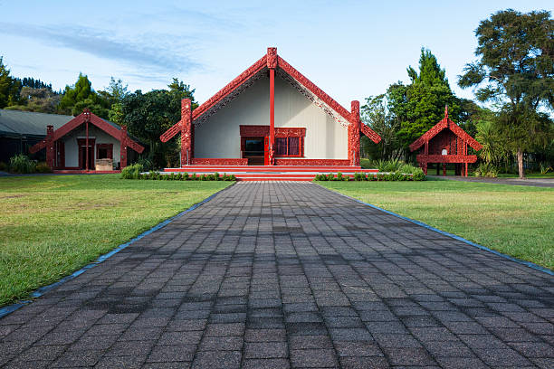 Māori wharenui meeting house in Rotorua, New Zealand Māori wharenui meeting house at a marae in Rotorua, New Zealand. A marae is a common communal public meeting area, that serves as a place of religious, cultural and social purposes for the Māori people. rotorua stock pictures, royalty-free photos & images