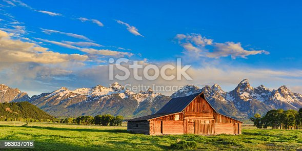 This vintage barn in Jackson Hole Wyoming has the Grand Tetons in the background.  Part of Mormon Row, it is listed on the National Register of Historic Places.