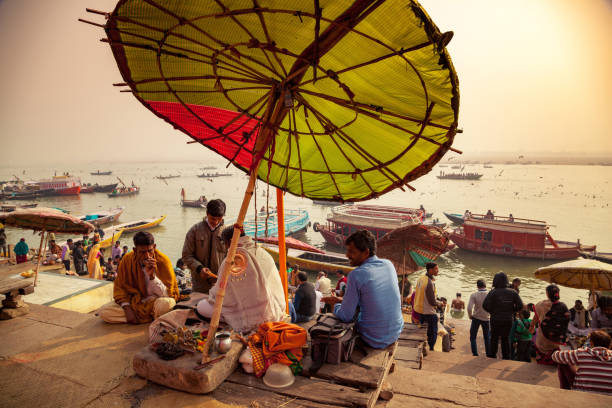 Morning activities at River Ganges during sunrise, Varanasi, India. stock photo
