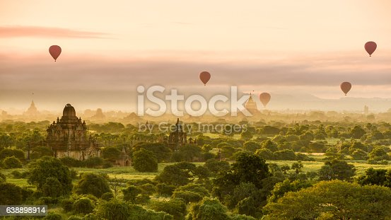 Hot air balloons dot the morning sky in Bagan, Myanmar