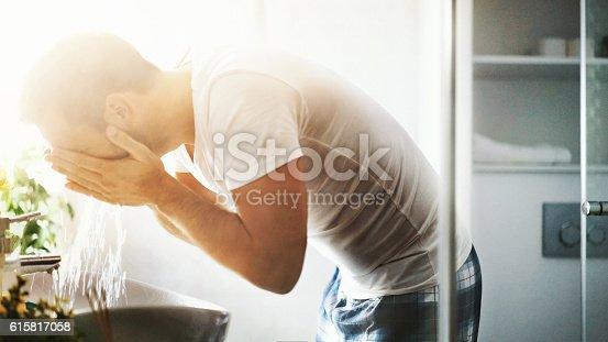 istock Morning bathroom refreshment. 615817058