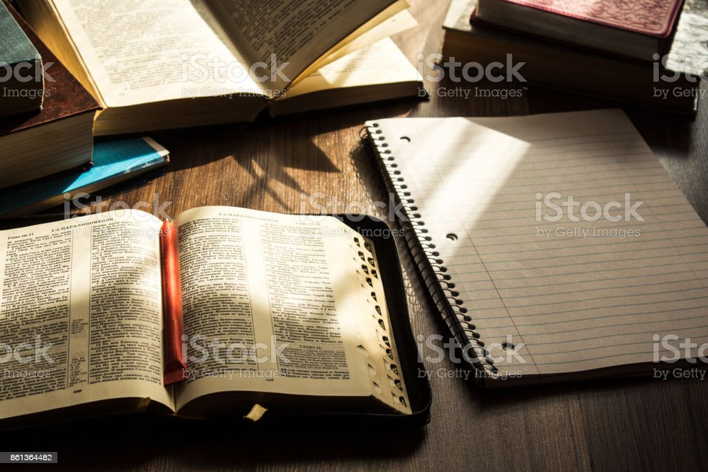 morning bible reading on wooden floor stock photo