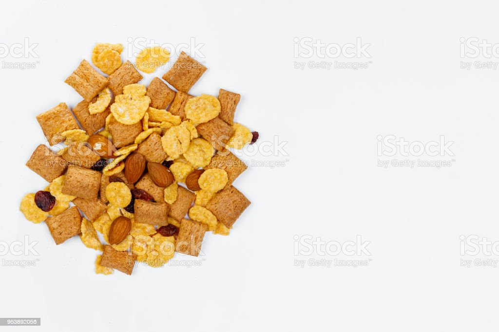 Morning breakfast. Bowl with homemade yogurt and cornflakes, raisins, almonds on white background, top view, flat lay. Concept of healthy food, healthy food, detox. Copy Space stock photo