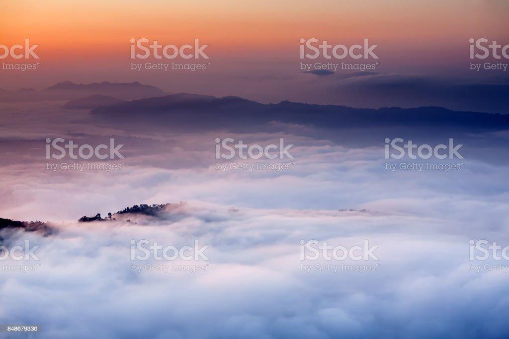 Morning clouds below Sarangkot view point near Pokhara in Nepal