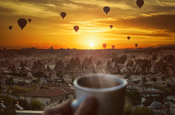 Morning coffe , Hot air balloons  and amazing beautiful sunrise stock photo