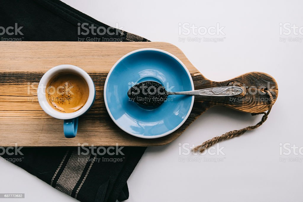 morning coffee and a spoon full of Ossetra caviar stock photo