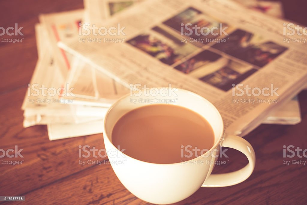 Morning Coffee and newspaper stock photo