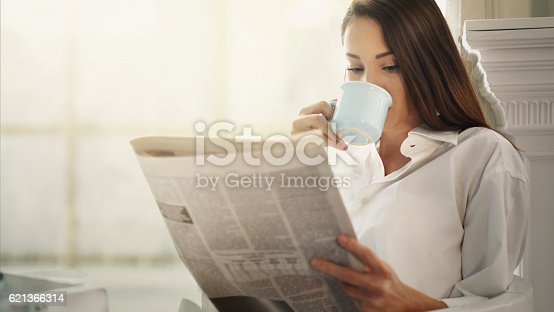 istock Morning coffee and newspapers. 621366314