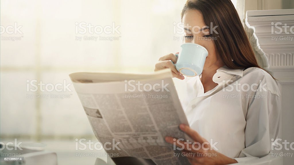 Morning coffee and newspapers. stock photo