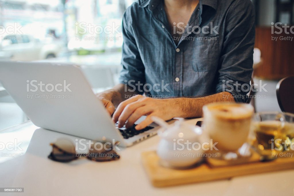 Morning coffee and work in Krabi Town, Thailand stock photo