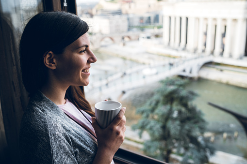 680846060 istock photo Morning coffee at window 1161361131