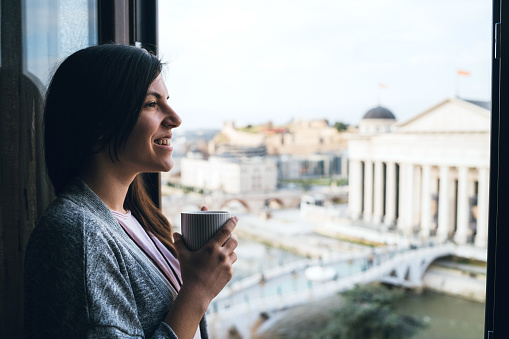680846060 istock photo Morning coffee at window 1161361215