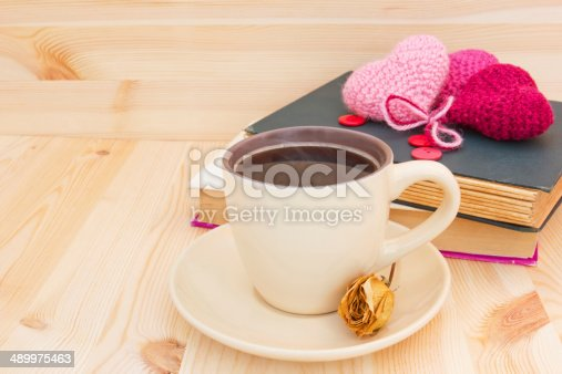 istock morning coffee, books and knitted hearts 489975463
