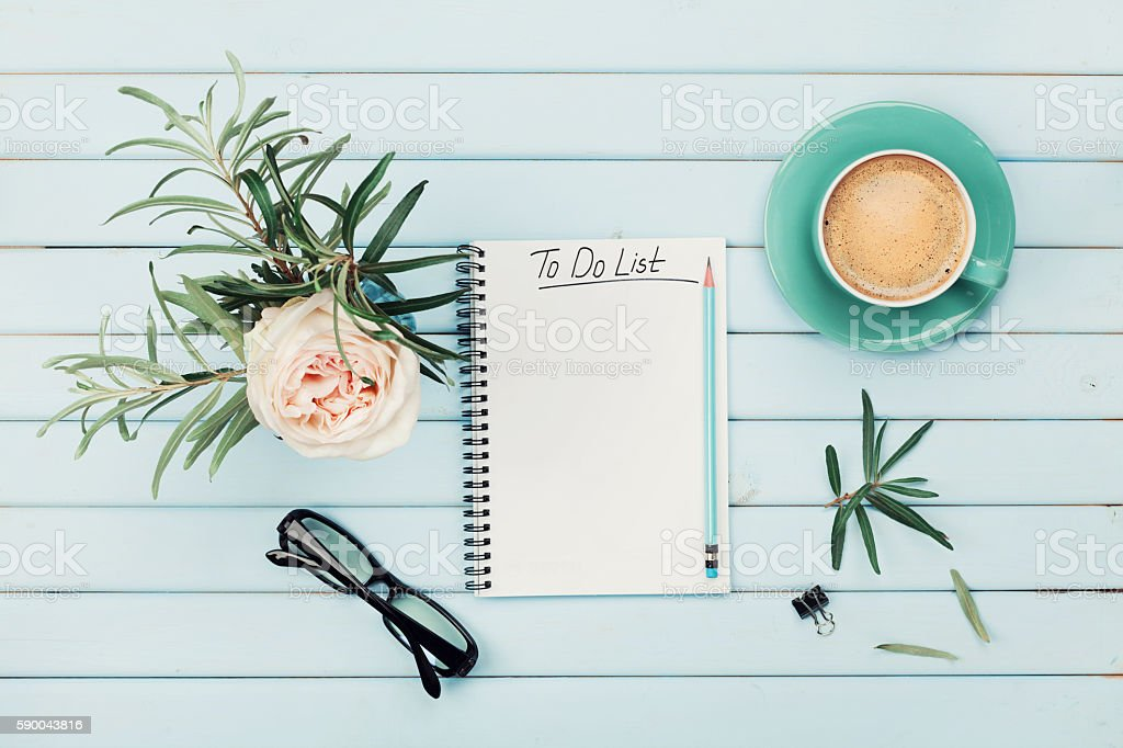 Morning coffee cup, notebook, rose flower. Planning and design concept. stock photo