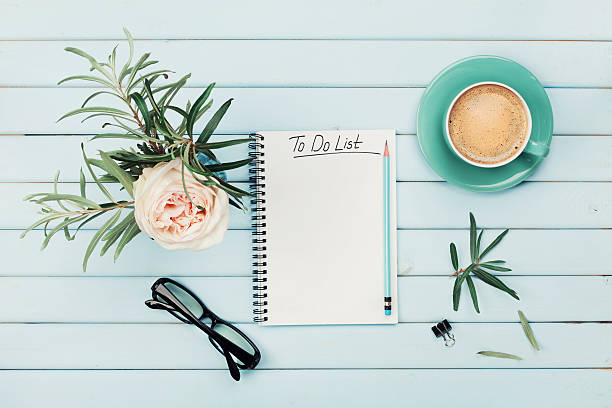 morning coffee cup, notebook, rose flower. planning and design concept. - to do list foto e immagini stock