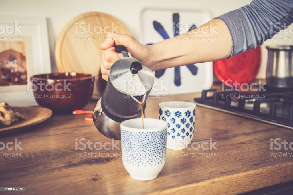 Morning coffee for two Time for coffee, woman Cooking morning coffee for two at home. Adult Stock Photo
