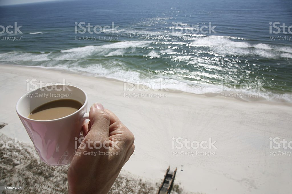 Morning Coffee on Balcony overlooking Beach and Ocean stock photo