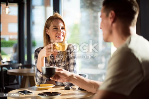 Young couple in cafeteria