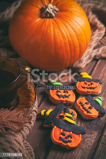 Morning coffee with gingerbread Halloween cookies on rustic wooden table