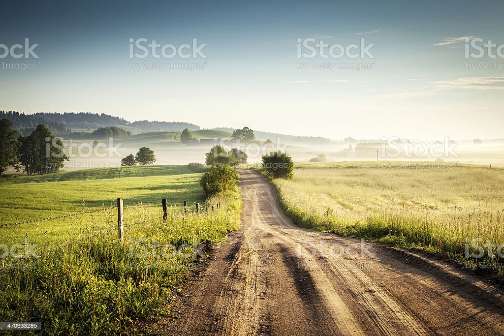 Morning Country Road through the Foggy Landscape - Colorful Countryside - Royalty-free Agricultural Field Stock Photo