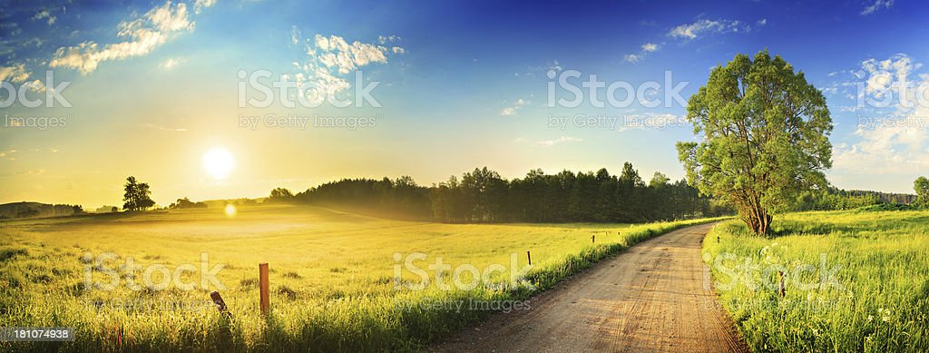 Morning Country Road through the Foggy Landscape - Colorful Sunrise - Royalty-free Agricultural Field Stock Photo
