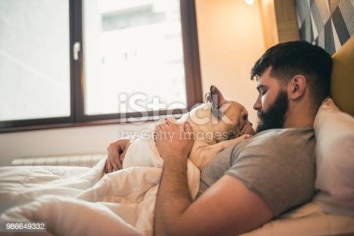 Morning cuddling, waking up with his dog