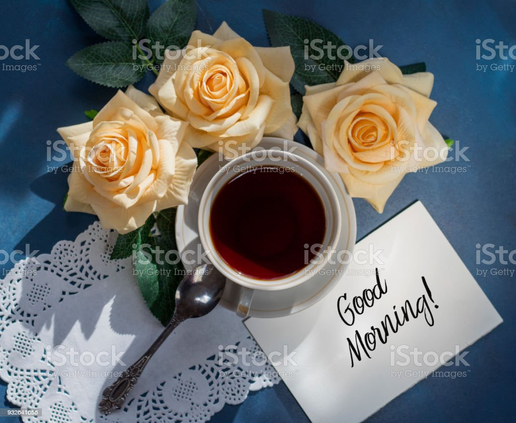Morning cup of coffee and a beautiful flowers rose stock photo morning cup of coffee and a beautiful flowers rose royalty free stock photo izmirmasajfo