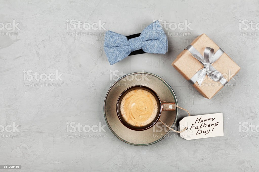 Morning cup of coffee, gift and bowtie. Flat lay style. Happy Fathers Day concept. stock photo