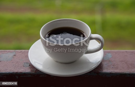 1135319558 istock photo Morning cup of coffee on green cabbage field background 696330416