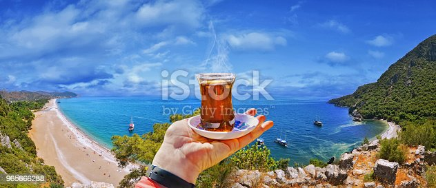 istock Morning cup of tea with view of colorful panoramic Olympos beach 965666288