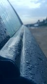 Early morning dew dropping on a car