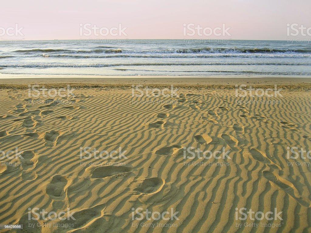 morning empty beach. footprints on sand royalty-free stock photo
