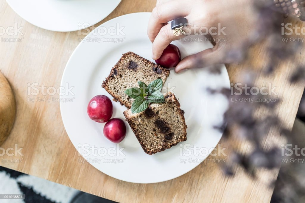 Morning flat lay with two slices of pancakes and fruits stock photo