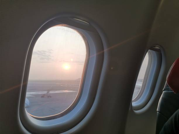 Morning flight looking thru cabin window Morning flight looking thru cabin window kuala lumpur airport stock pictures, royalty-free photos & images