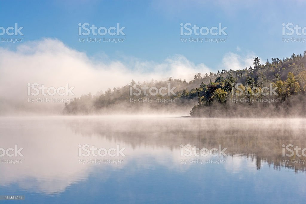 Morning Fog and Clouds in the North Woods stock photo